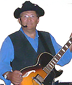 Roger Chartier wtih blue shirt and guitar