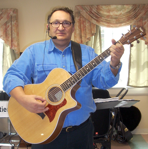 Roger Chartier plays a Taylor guitar